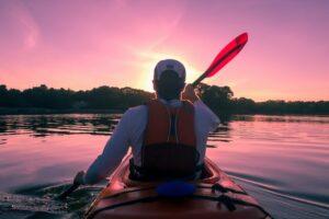 man paddling with life jacket on
