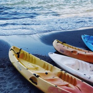 kayaks cans on the beach